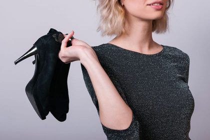 woman_holding_shoes_720x480
